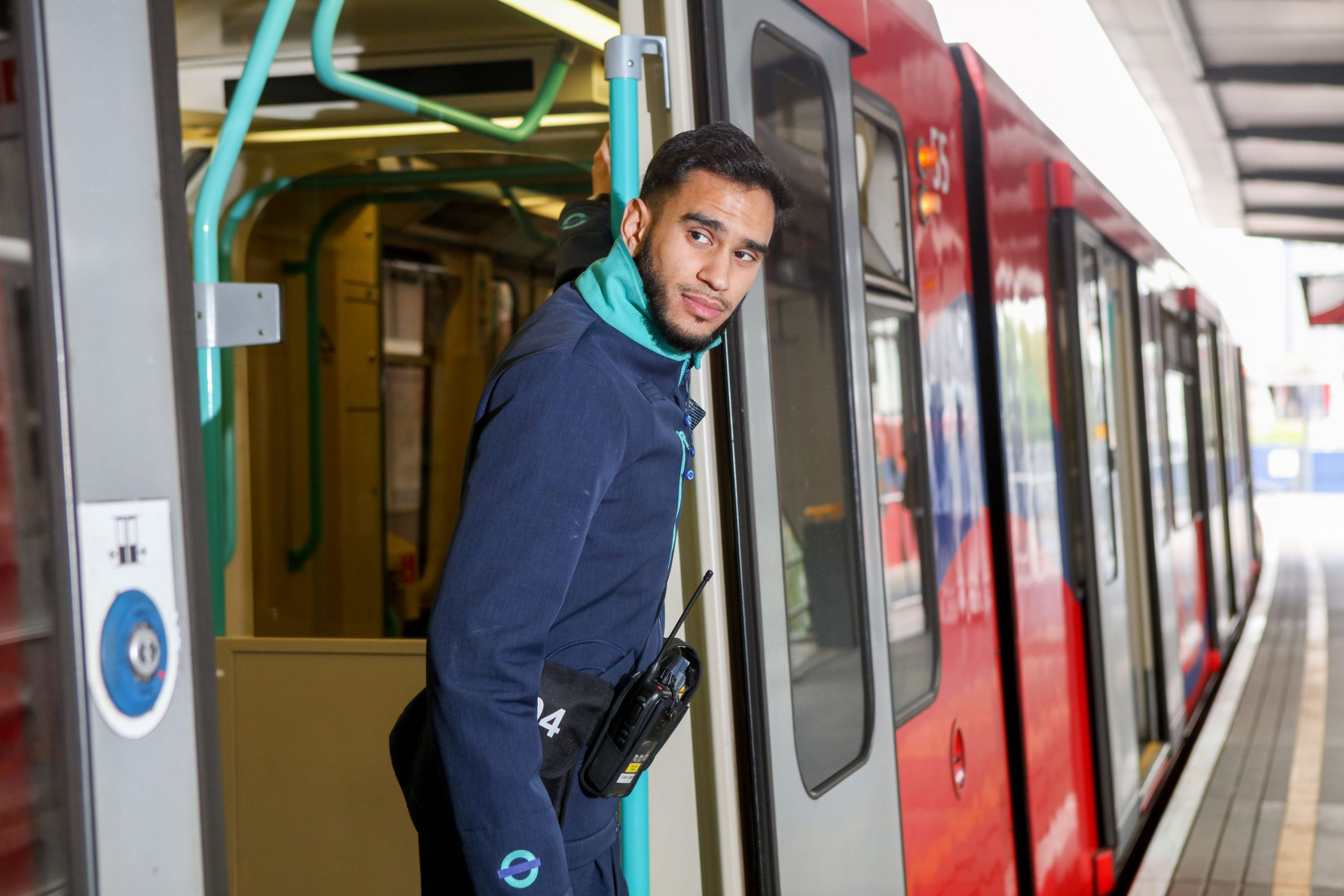 DLR staff member on train